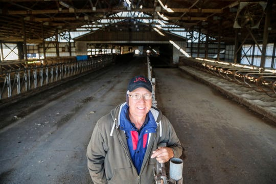 Eric Lyon stands in his family's empty dairy cow barn last month in Toledo. His family has liquidated most of its 320 cows and is switching to beef cattle because of a punishing downturn in the U.S. dairy industry.
