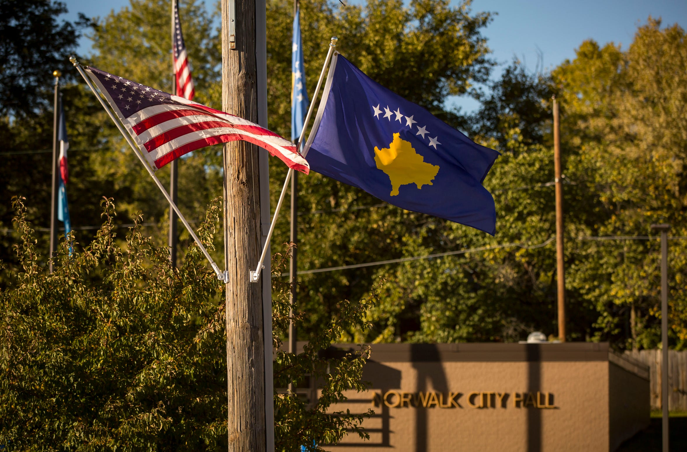 The flag of the Republic of Kosovo flies in front of  Norwalk City Hall Wednesday, Oct. 18, 2018. Norwalk became the sister city for Vustrri, Kosovo, in 2018.