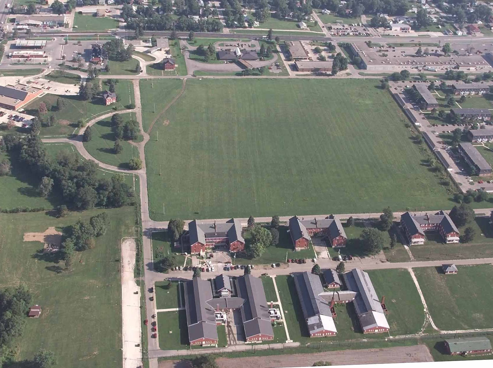 An aerial of Fort Des Moines showing the parade field (top) and the former barracks (bottom).