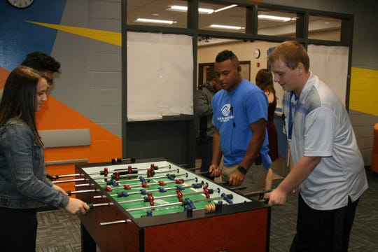 The new McCombs Boys and Girls Club has fun activities for students, including a foosball table.