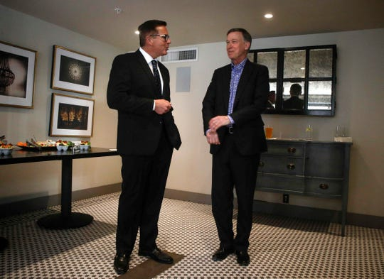 Matt McCoy meets with Colorado Democratic governor John Hickenlooper, Jr., right, during a visit to Bubba in downtown Des Moines after his speech at the World Food Prize's Borlaug Diaries on Friday, Oct. 19, 2018.