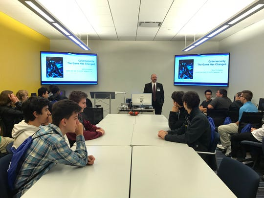 A group of students from Henry Ford II High School, taking a brand new cybersecurity elective, met with Professor Dave Schippers in the Walsh College CyberLab to talk about the evolving field of cybersecurity on Oct. 19, 2018.