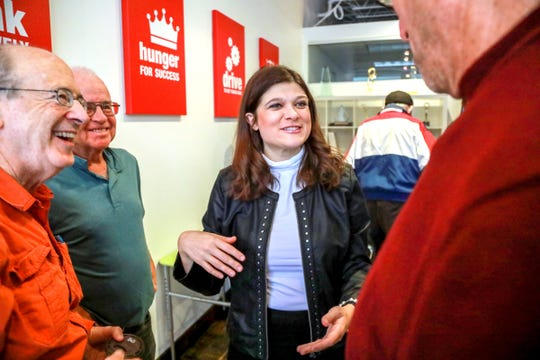 Haley Stevens, Democratic candidate for the 11th Congressional district, talks to volunteers before they head out to canvas for Stevens in Birmingham, Mich. on Saturday, Oct. 6, 2018.