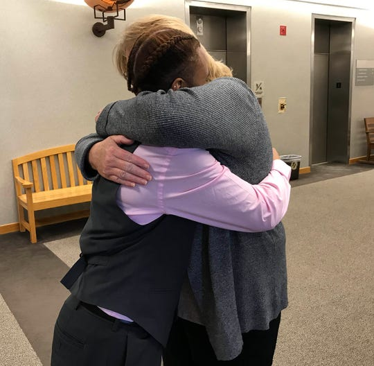 C'Nai Lange, 17, and her mom, Kathy Lange, both of Macomb Township, hug after the Lange family adopted C'Nai on Oct. 19, 2018 in Macomb County Circuit Court.