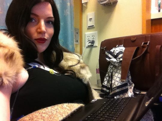 Jessica Tousignant in chemotherapy in Seattle, working, with a wig and fur.