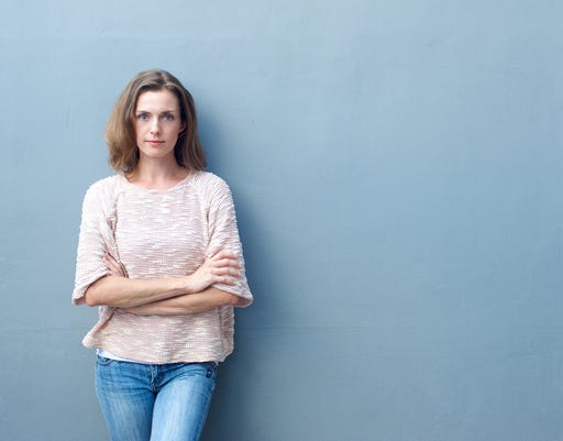 Confident Mid Adult Woman Posing With Arms Crossed