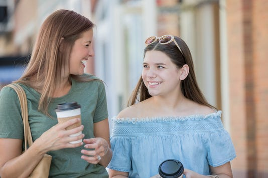 Mom Hanging Out With Teenager Daughter At Outdoor Mall