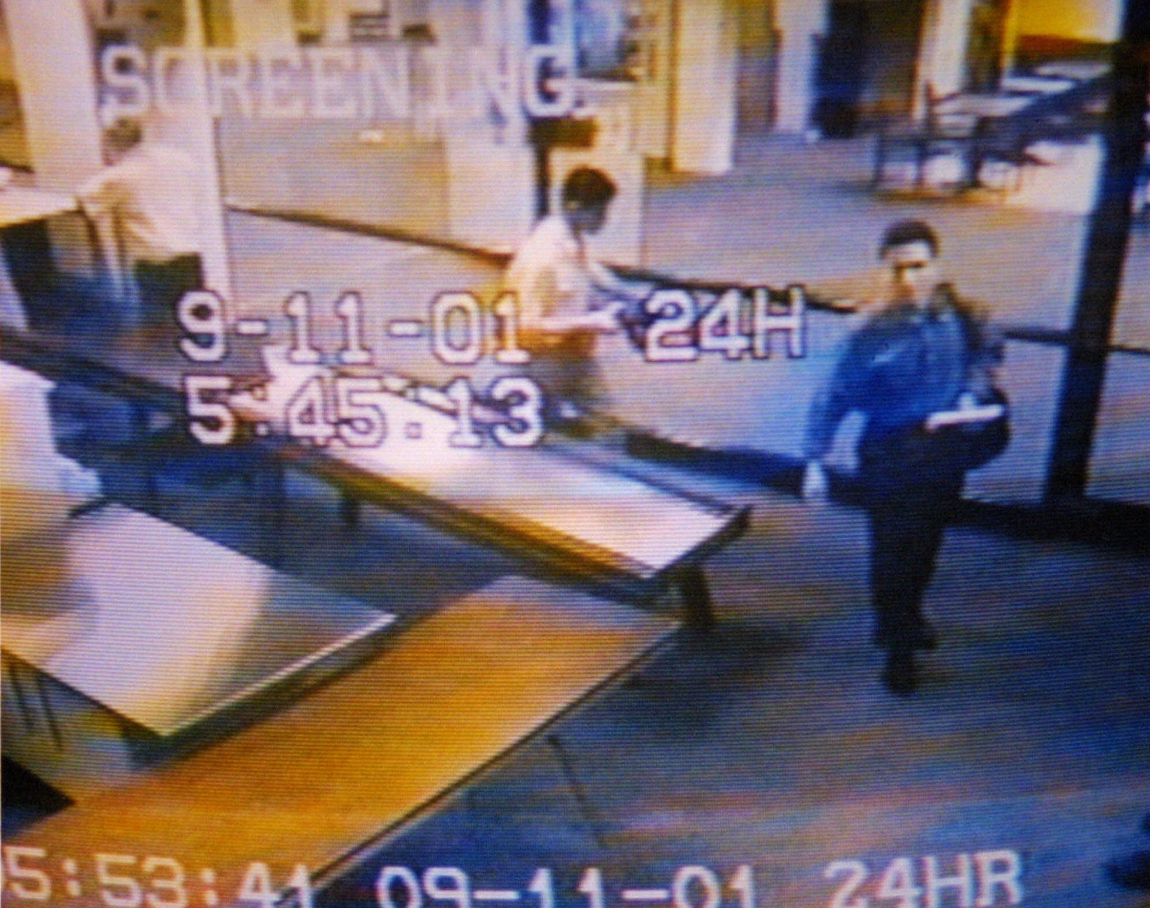 Two men, identified by authorities as suspected hijackers Mohamed Atta, right, and Abdulaziz Alomari, center, pass through airport security, Tuesday, Sept. 11, 2001 at Portland International Jetport in this photo from the airport surveillance tape released Wednesday, Sept. 19, 2001. Authorities say the two men took a commuter flight to Boston before boarding American Airlines Flight 11 which was one of four jetliners hijacked Sept. 11, 2001, and one of two which were crashed into the World Trade Center.
