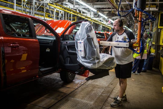 Tim Bliznik, a Michigan Assembly Plant employee, trains in September to install seats in a 2019 Ford Ranger.