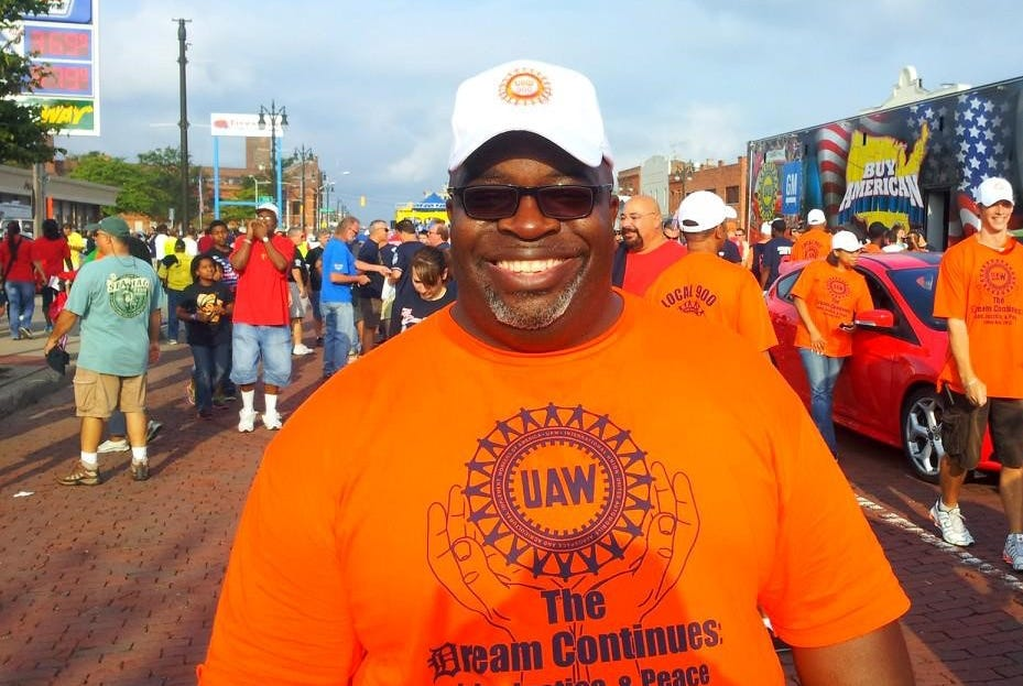 Walter Robinson, a UAW quality representative at Michigan Assembly Plant, walks in Detroit's 2013 Labor Day parade.