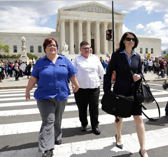 April DeBoer, left, and Jayne Rouse in front of the U.S. Supreme Court in Washington D.C. on Tuesday, April 28, 2015 with their attorney Dana Nessel.