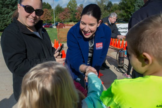 Congressional candidate Lena Epstein shakes hands with Zoey Crynick, 8, of Canton as her brother, Cooper, 11, and mother, Michelle Crynick, look on duing an open house at Plymouth Township's fire department on Saturday, Oct. 13, 2018.