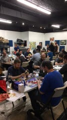 Gate Keeper Games in Berkley will nearly double its space when it moves into the old Doll Hospital & Toy Soldier Shop on 12 Mile Road, allowing it to host more gaming tournaments and social events like this one.