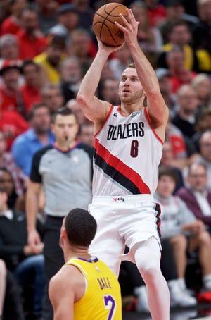 Portland Trail Blazers guard Nik Stauskas  shots over Los Angeles Lakers guard Lonzo Ball on Thursday night.
