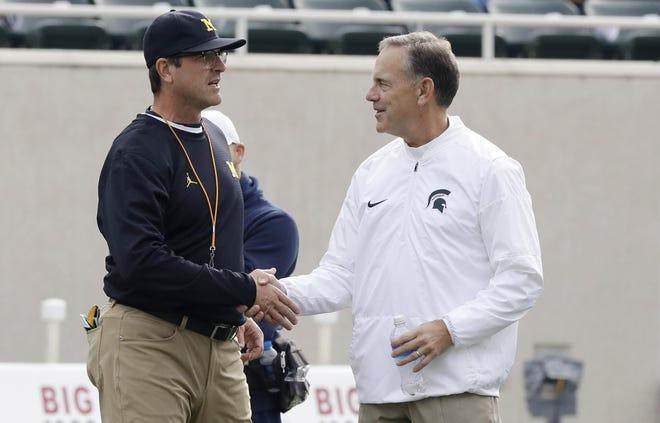Michigan coach Jim Harbaugh, left, is 1-2 against Michigan State coach Mark Dantonio.
