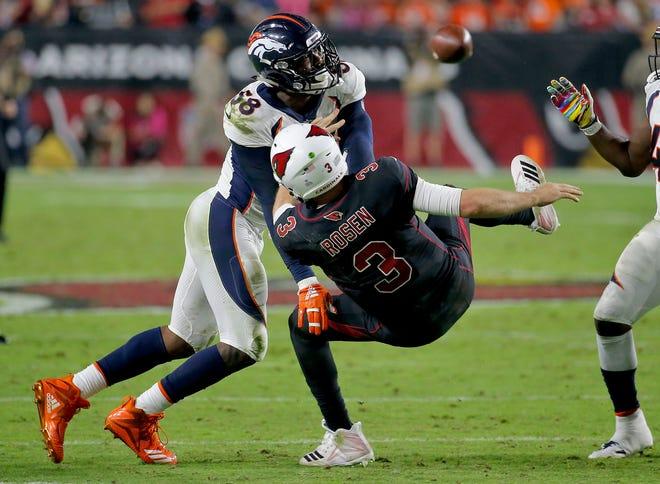Denver Broncos linebacker Von Miller (58) hits Arizona Cardinals quarterback Josh Rosen (3) as he throws during the second half on Thursday.