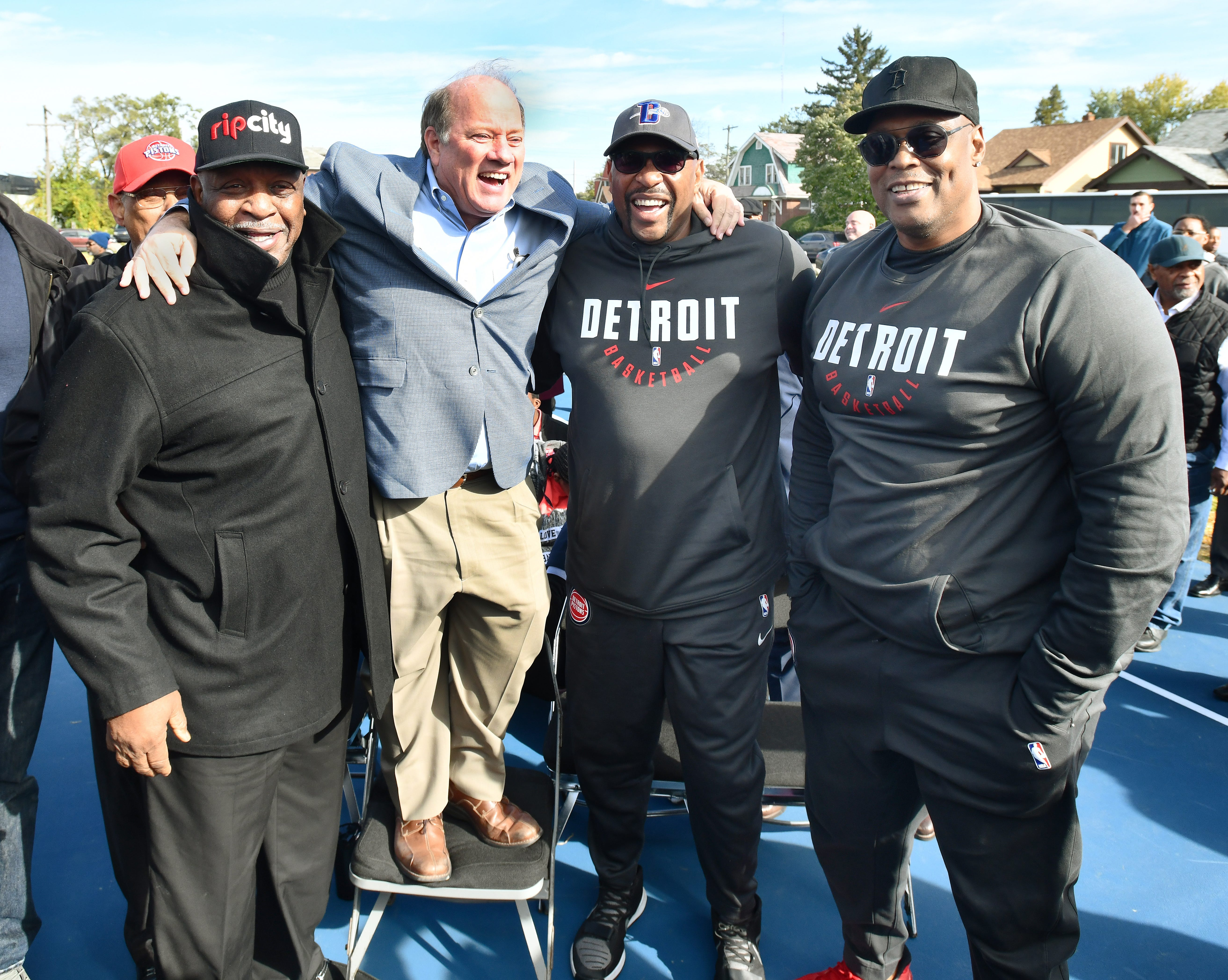 """Possibly the new """"Bad Boys"""" of Detroit, from left, 1969 Detroit Pistons draft pick  Willie Norwood; two-term Detroit Mayor Mike Duggan, who climbed up on a folding chair to get in the picture; two-time NBA Champion Earl """"The Twirl"""" Cureton, and original """"Bad Boy,"""" 1989 NBA Champion Rick Mahorn.  The mayor and former Pistons attended the unveiling of the first of 60 renovated basketball courts in 50 city parks, Friday."""