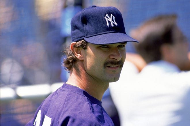 Evansville native Don Mattingly looks on during batting practice during his playing days with the New York Yankees, in 1988.