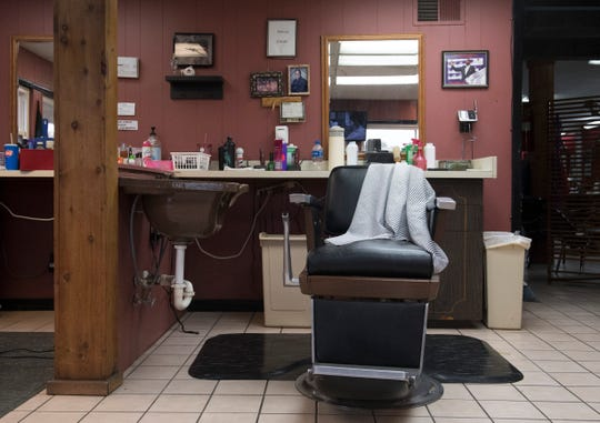 Eddie Geis barber chair sits empty Friday afternoon in his barber shop off S. Barker Avenue on the West Side of Evansville. Geis opened the barber shop in 1965. He passed away Thursday at age 77 after a battle with cancer.