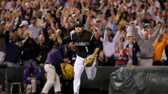 Jamey Carroll of the Colorado Rockies celebrates after finishing off a double play to end the 11th inning against the San Diego Padres in the Wild Card playoff game at Coors Field on October 1, 2007 in Denver, Colorado.