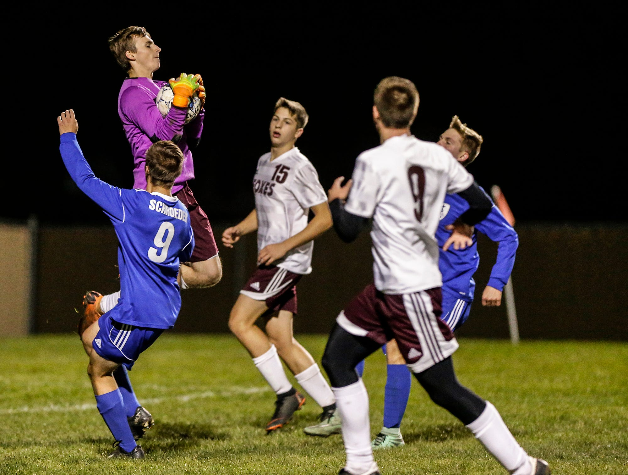 Omro High School soccer's Zachary Milner goes up to block a ball kicked by a Winnebago Lutheran Academy player during their WIAA regional playoff game Thursday, October 18, 2018 in Fond du Lac, Wisconsin. Doug Raflik/USA TODAY NETWORK-Wisconsin