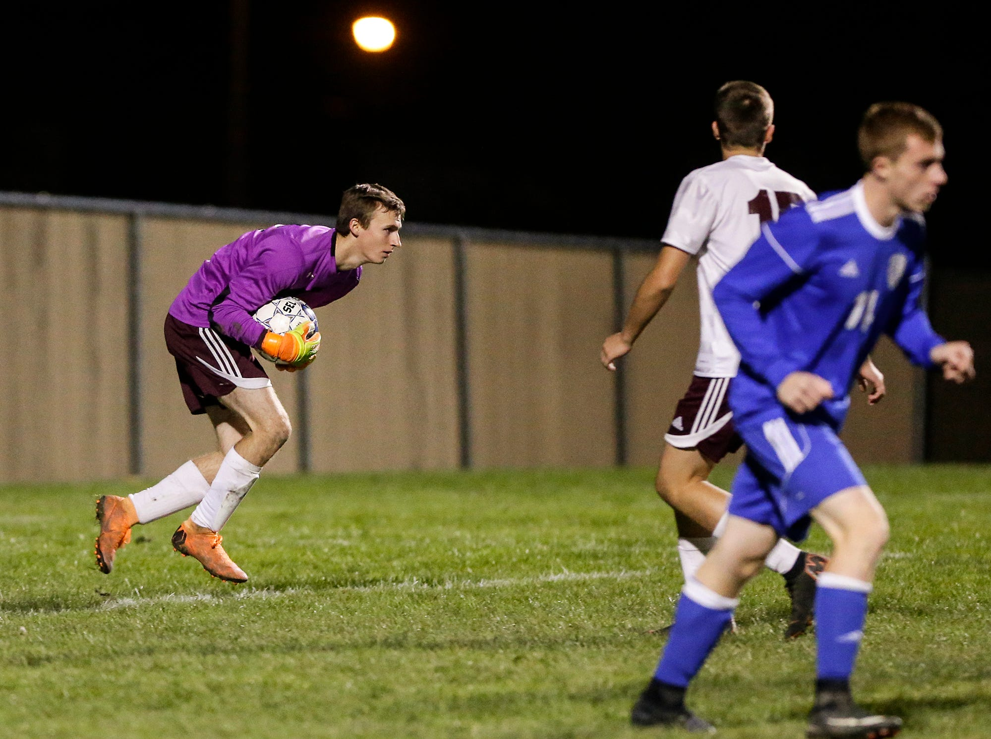 Omro High School soccer's Zachery Milner stops a ball from scoring against Winnebago Lutheran Academy during their WIAA regional playoff game Thursday, October 18, 2018 in Fond du Lac, Wisconsin. Doug Raflik/USA TODAY NETWORK-Wisconsin