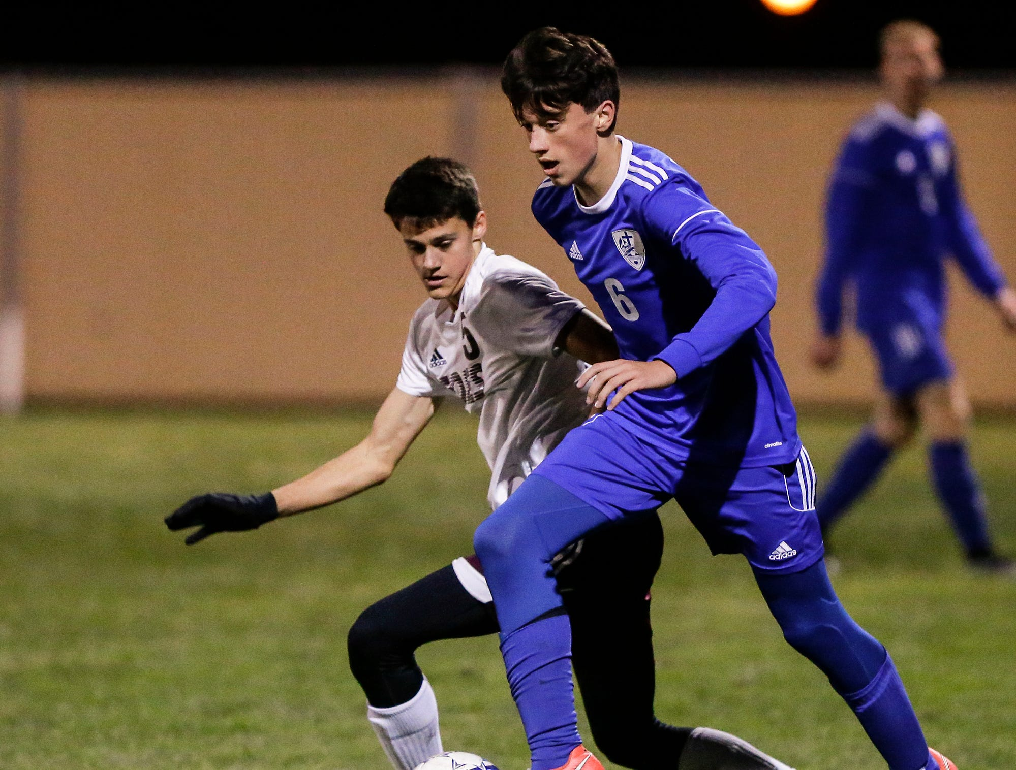 Winnebago Lutheran Academy soccer's Colin Knoblock and Omro High School's Eli Kilgas battle for the ball during their WIAA regional playoff game Thursday, October 18, 2018 in Fond du Lac, Wisconsin. Doug Raflik/USA TODAY NETWORK-Wisconsin