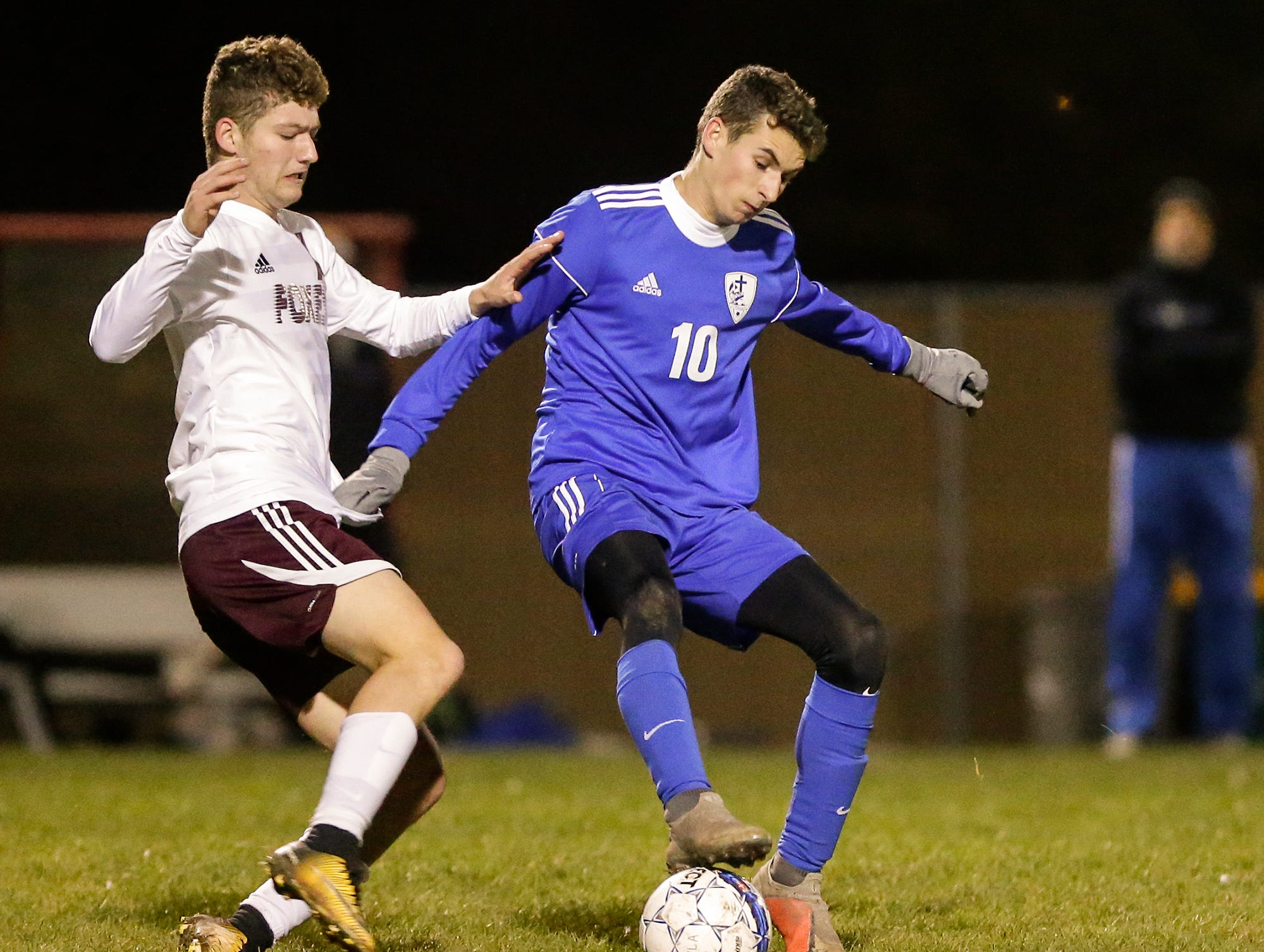 Winnebago Lutheran Academy soccer's Nathan Schmidt battles for the ball against Omro High School's Sam Smits during their WIAA regional playoff game Thursday, October 18, 2018 in Fond du Lac, Wisconsin. Doug Raflik/USA TODAY NETWORK-Wisconsin
