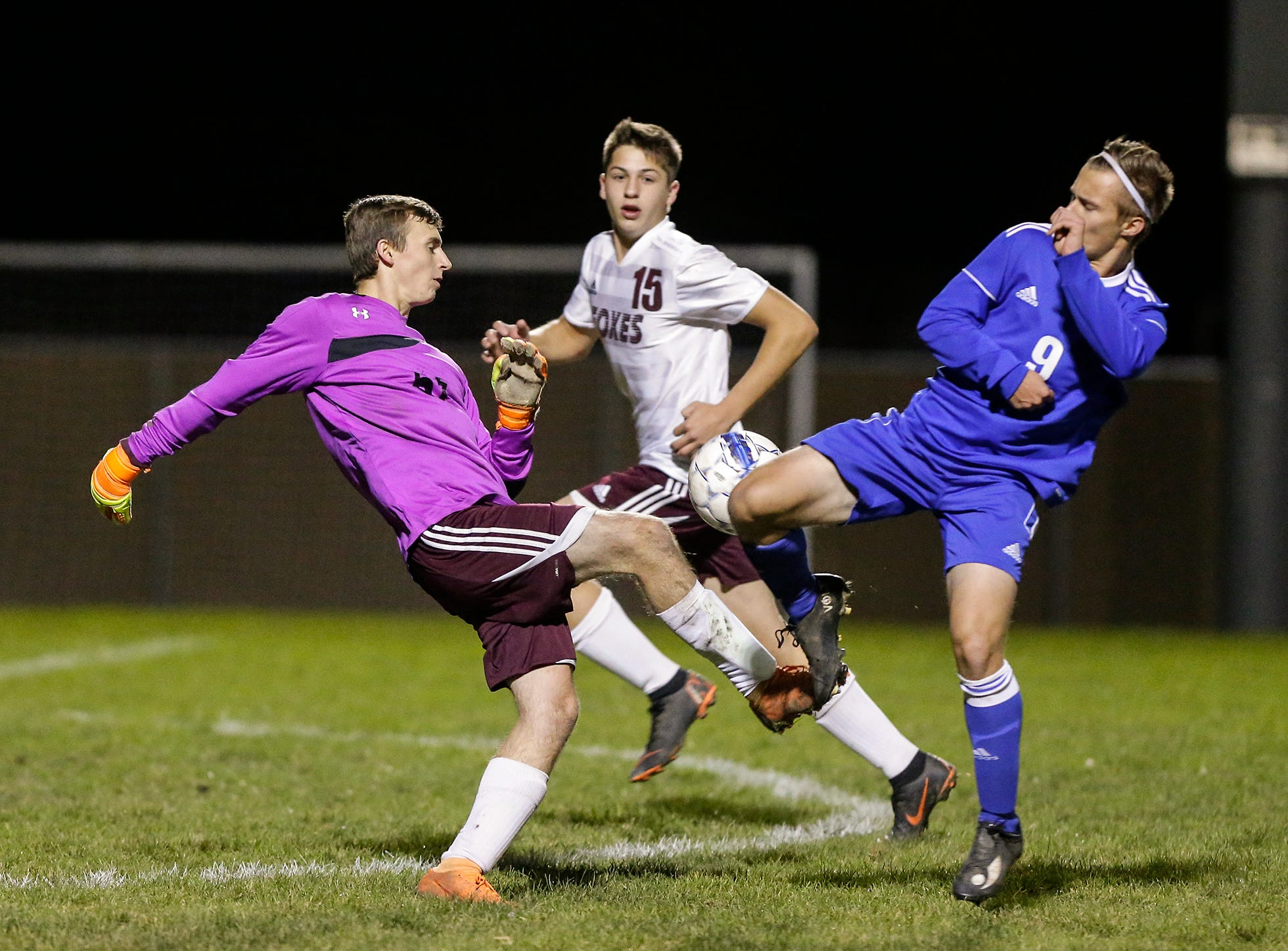 Omro High School soccer's Zachery Milner and Winnebago Lutheran Academy's Kaleb Schroeder battle for the ball during their WIAA regional playoff game Thursday, October 18, 2018 in Fond du Lac, Wisconsin. Doug Raflik/USA TODAY NETWORK-Wisconsin