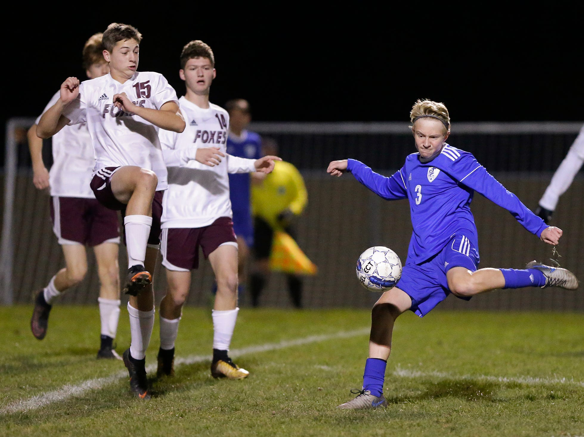 Winnebago Lutheran Academy soccer's Carter Sampson kicks the ball against Omro High School during their WIAA regional playoff game Thursday, October 18, 2018 in Fond du Lac, Wisconsin. Doug Raflik/USA TODAY NETWORK-Wisconsin