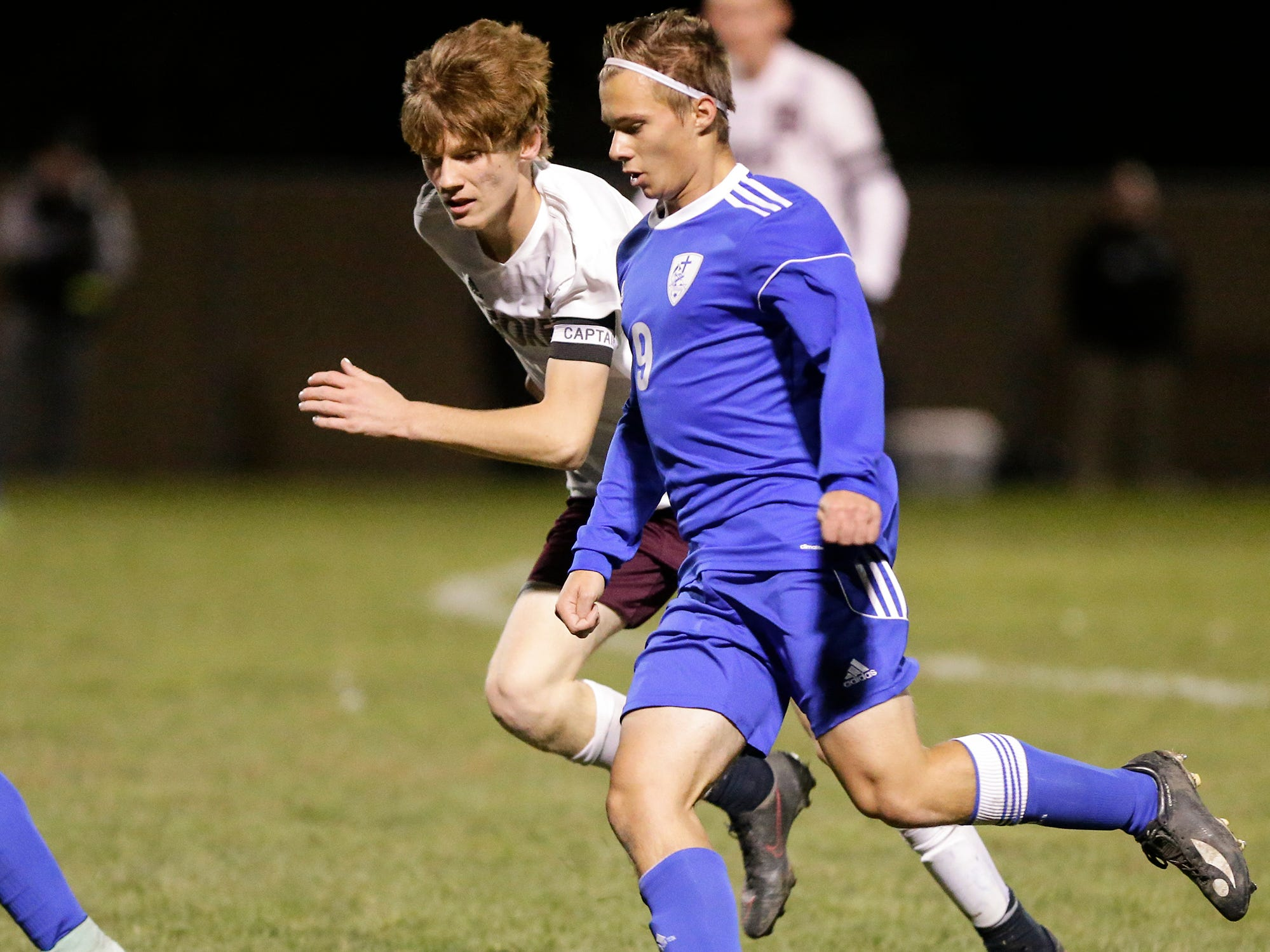 Winnebago Lutheran Academy soccer's Kaleb Schroeder kicks the ball down field against Omro High School's Garrett Ellis during their WIAA regional playoff game Thursday, October 18, 2018 in Fond du Lac, Wisconsin. Doug Raflik/USA TODAY NETWORK-Wisconsin
