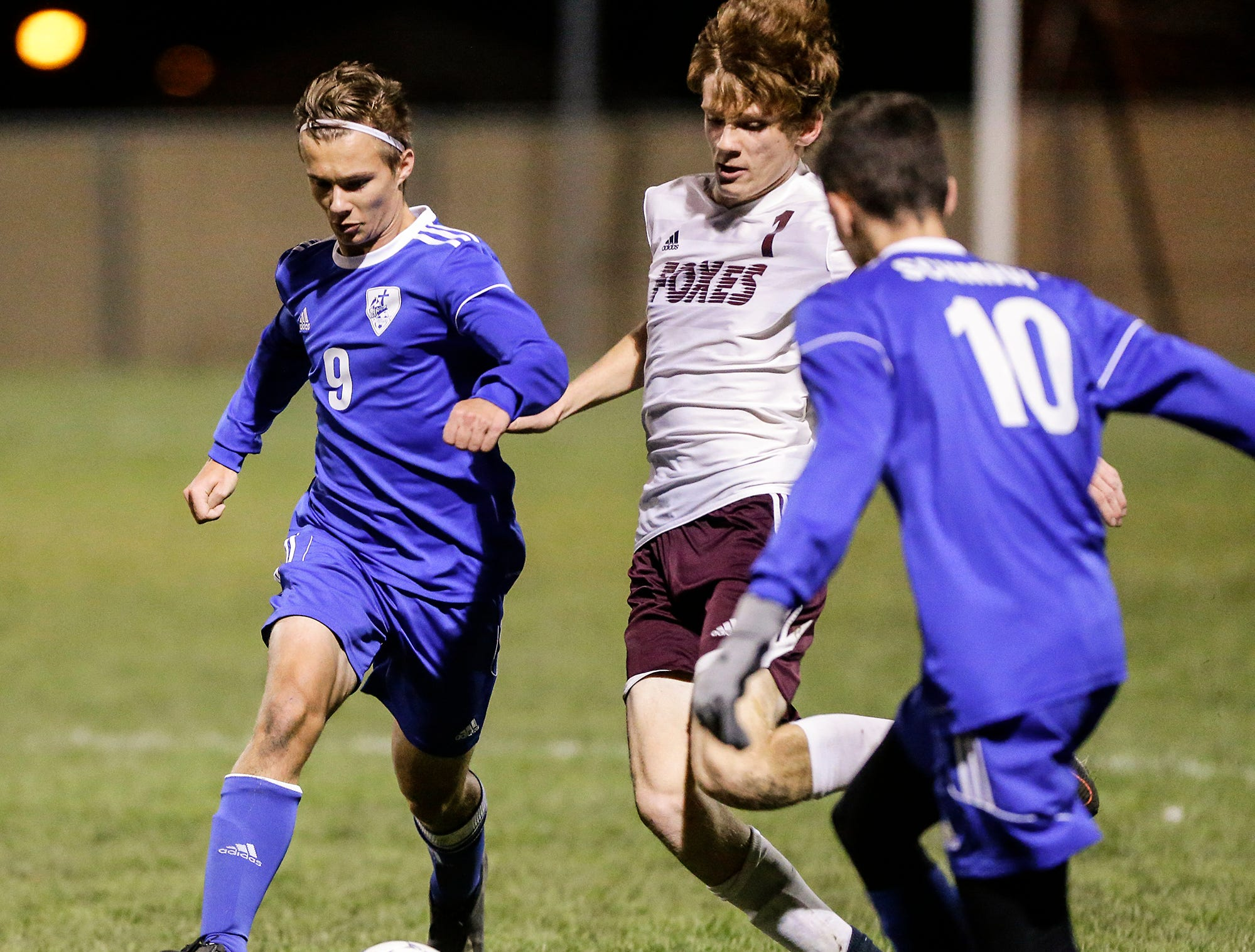 Winnebago Lutheran Academy soccer's Kaleb Schroeder battles for the ball against Omro High School's Garrett Ellis during their WIAA regional playoff game Thursday, October 18, 2018 in Fond du Lac, Wisconsin. Doug Raflik/USA TODAY NETWORK-Wisconsin
