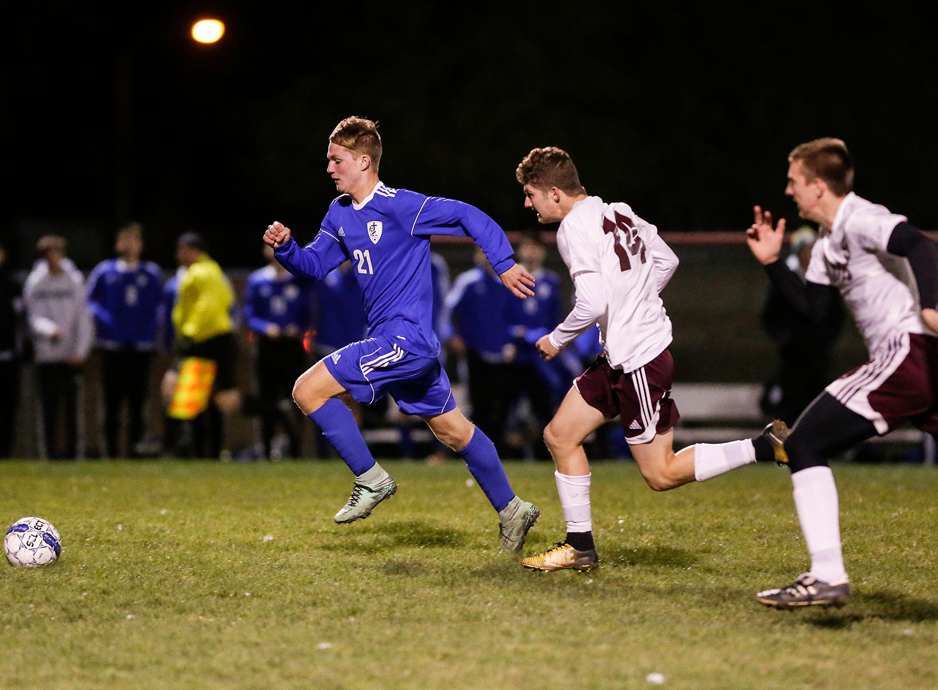 Winnebago Lutheran Academy soccer's Tyler Kuske works his way down the field against Omro High School during their WIAA regional playoff game Thursday, October 18, 2018 in Fond du Lac, Wisconsin. Doug Raflik/USA TODAY NETWORK-Wisconsin