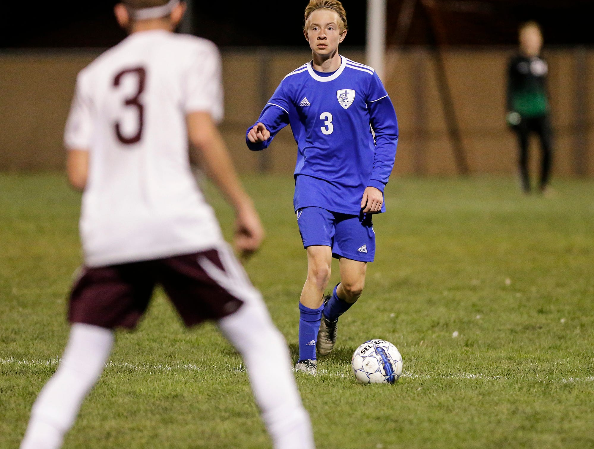 Winnebago Lutheran Academy soccer's Carter Sampson directs his next move against Omro High School during their WIAA regional playoff game Thursday, October 18, 2018 in Fond du Lac, Wisconsin. Doug Raflik/USA TODAY NETWORK-Wisconsin
