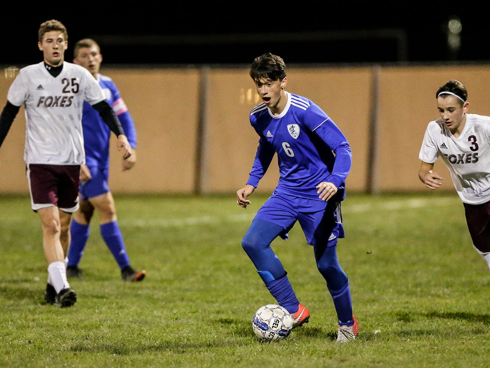 Winnebago Lutheran Academy soccer's Colin Knoblock controls the ball against Omro High School during their WIAA regional playoff game Thursday, October 18, 2018 in Fond du Lac, Wisconsin. Doug Raflik/USA TODAY NETWORK-Wisconsin