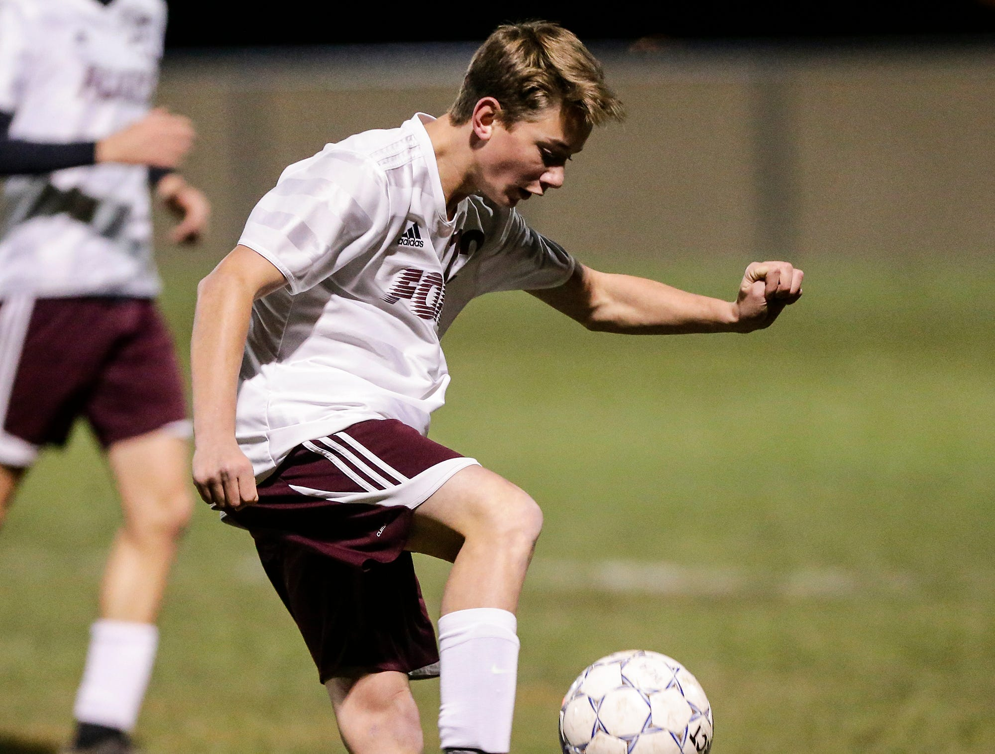 Omro High School soccer's Kaden Besaw gets the ball against Winnebago Lutheran Academy during their WIAA regional playoff game Thursday, October 18, 2018 in Fond du Lac, Wisconsin. Doug Raflik/USA TODAY NETWORK-Wisconsin