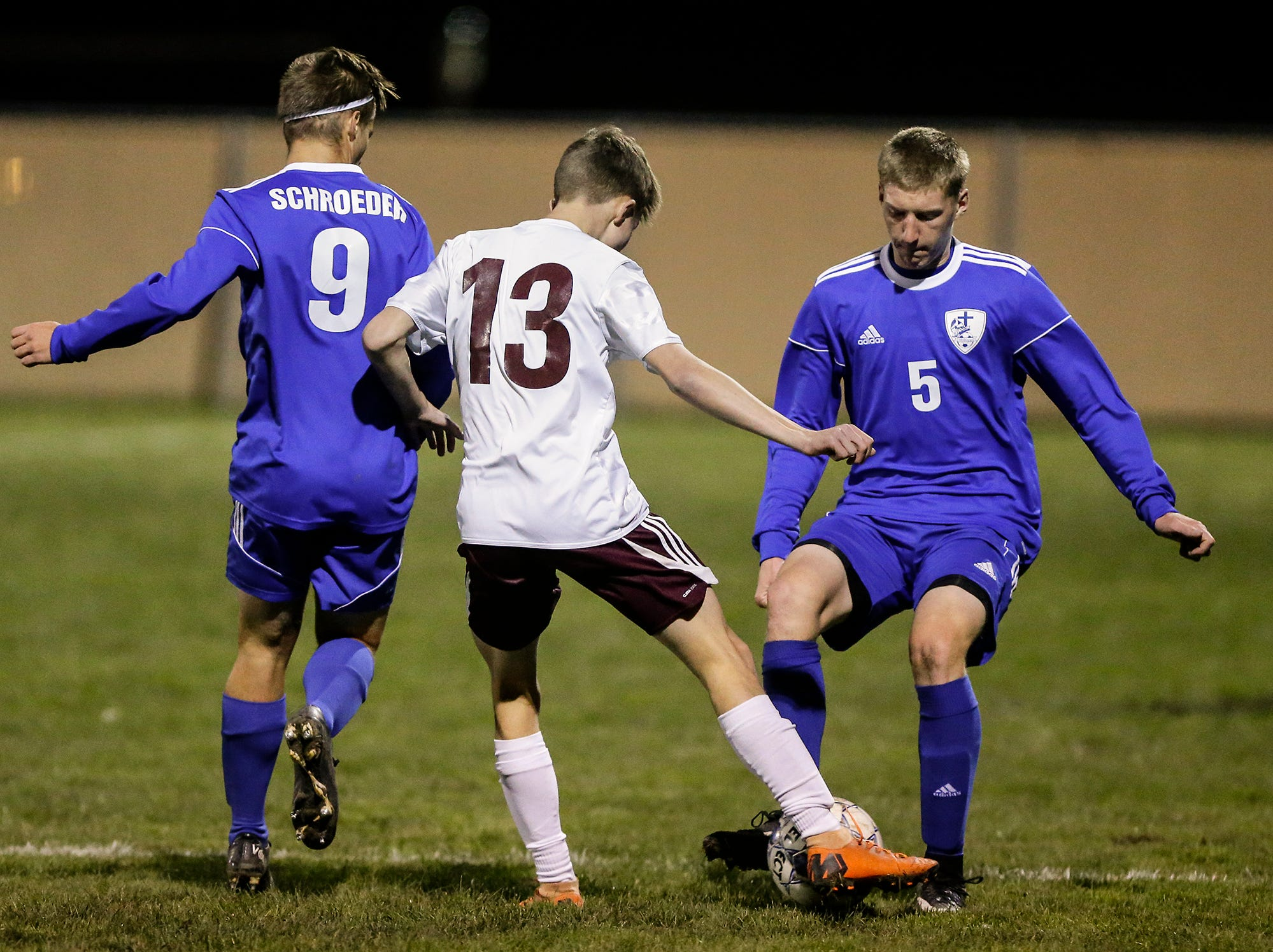 Winnebago Lutheran Academy soccer's Nathan Pausma (5) battles for the ball with an Omro High School player during their WIAA regional playoff game Thursday, October 18, 2018 in Fond du Lac, Wisconsin. Doug Raflik/USA TODAY NETWORK-Wisconsin