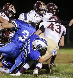 St. Mary's Springs Academy football's Trent Schueffner tackles Omro's Garrett Dahms Friday, September 21, 2018, during their game at Fruth Field in Fond du Lac. Trent was killed Friday, Oct. 19 in a duck hunting accident in Calumet County.