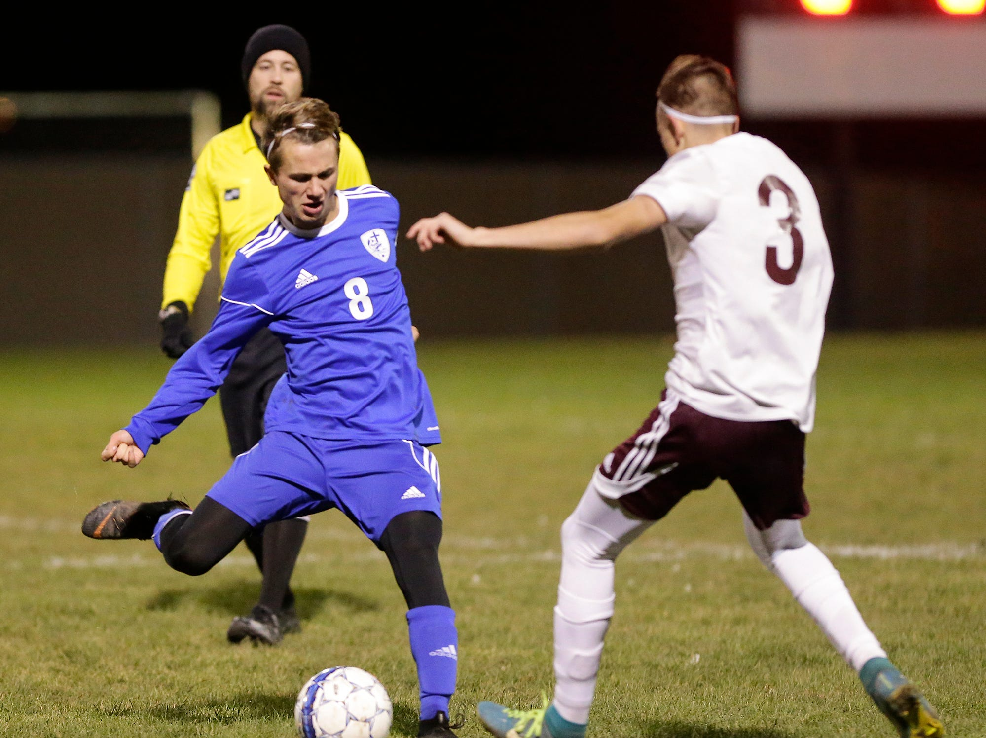 Winnebago Lutheran Academy soccer's Jack Rabe kicks the ball against Omro High School's Erin Clifford during their WIAA regional playoff game Thursday, October 18, 2018 in Fond du Lac, Wisconsin. Doug Raflik/USA TODAY NETWORK-Wisconsin