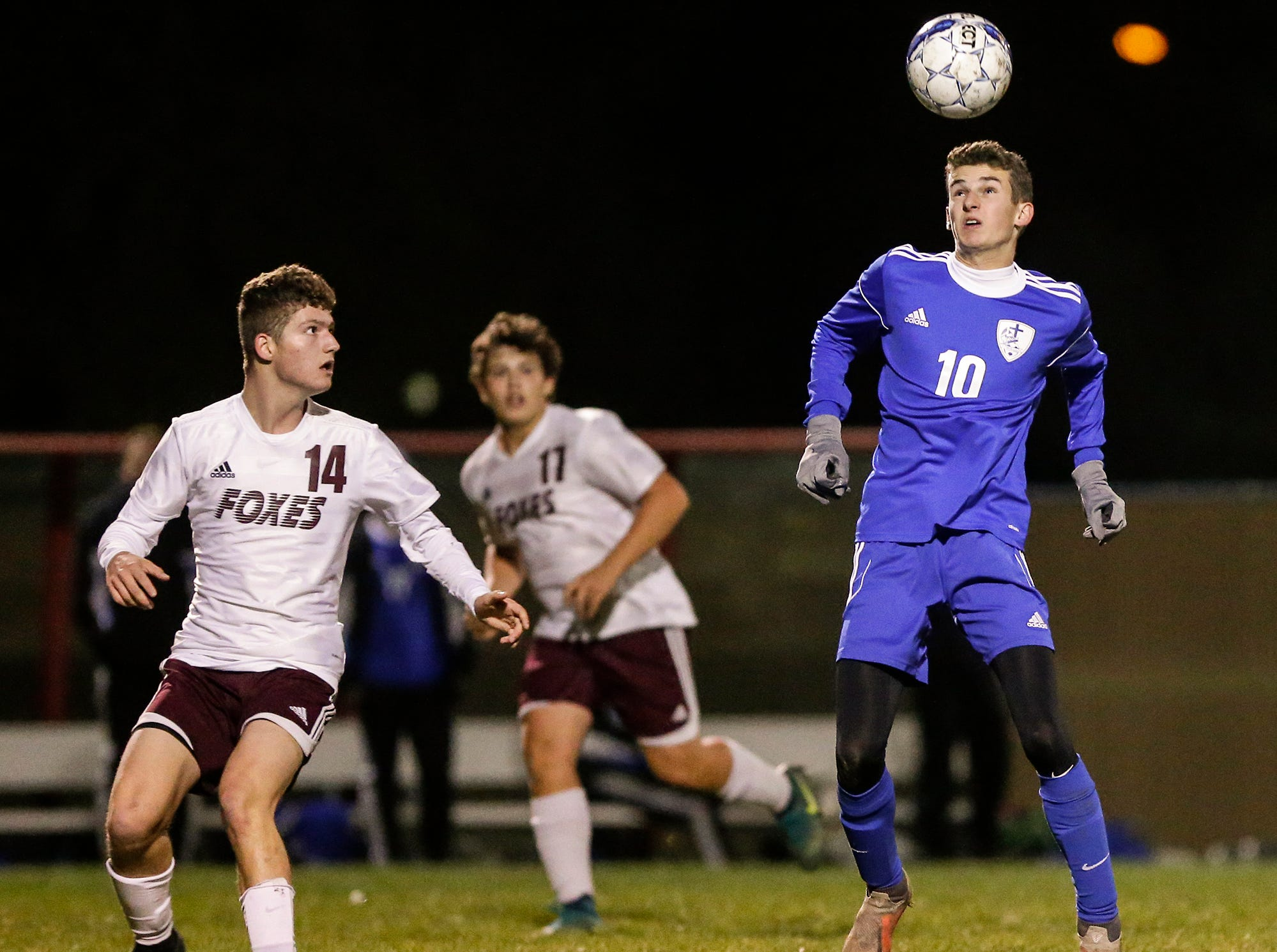 Winnebago Lutheran Academy soccer's Nathan Schmidt bumps the ball with his head against Omro High School during their WIAA regional playoff game Thursday, October 18, 2018 in Fond du Lac, Wisconsin. Doug Raflik/USA TODAY NETWORK-Wisconsin