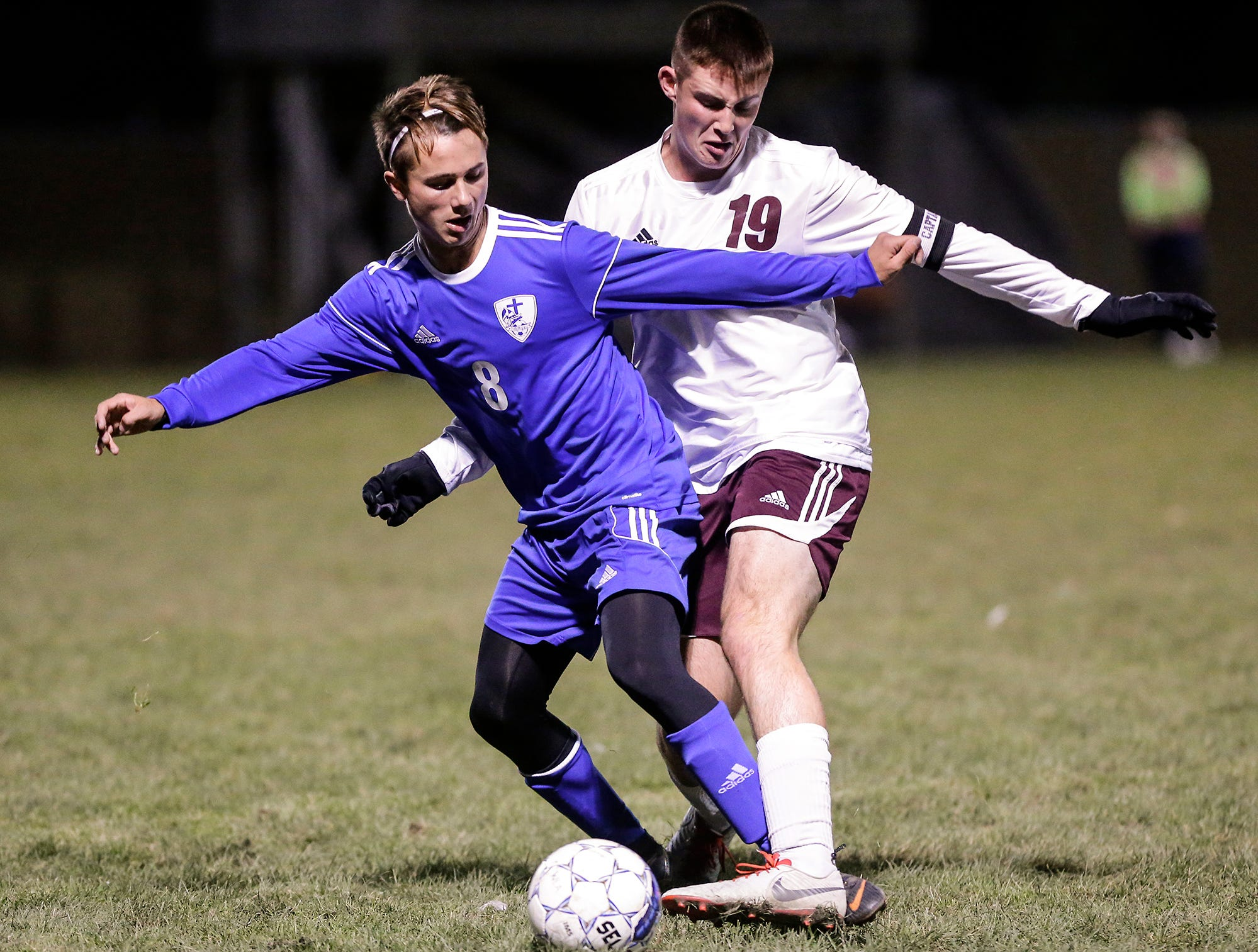 Winnebago Lutheran Academy soccer's Jack Rabe  battles for the ball against Omro High School's Evan Gitter during their WIAA regional playoff game Thursday, October 18, 2018 in Fond du Lac, Wisconsin. Doug Raflik/USA TODAY NETWORK-Wisconsin