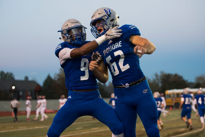 Poudre High School sophomore receiver Duante Davis (9) celebrates a touchdown catch with senior defensive lineman Landon Correll (62) during a game against Fairview High School on Thursday, Oct. 18, 2018, at French Field in Fort Collins, Colo.