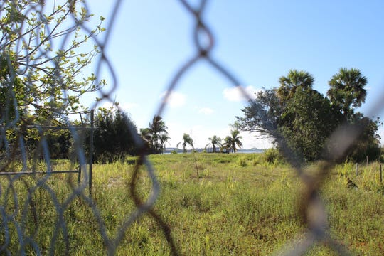 Charlotte Harbor is in the background of this photo that was taken through a chain-link fence around land that Allegiant Travel Co. will transform into an upscale waterfront resort. This photo was taken on Oct. 18, 2018.