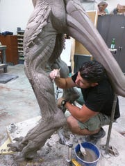 Wayne Anderson hard at work in Hollywood sculpting a monster out of clay.