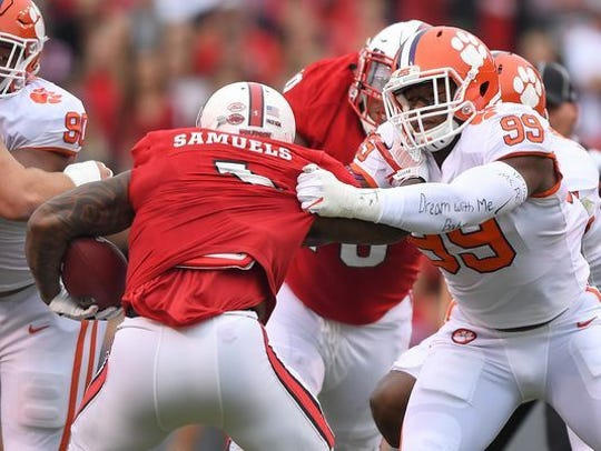 Clemson's Clelin Ferrell (99) corrals N.C. State's Jaylen Samuels during the Tigers' 38-31 win in Raleigh, N.C., in 2017.