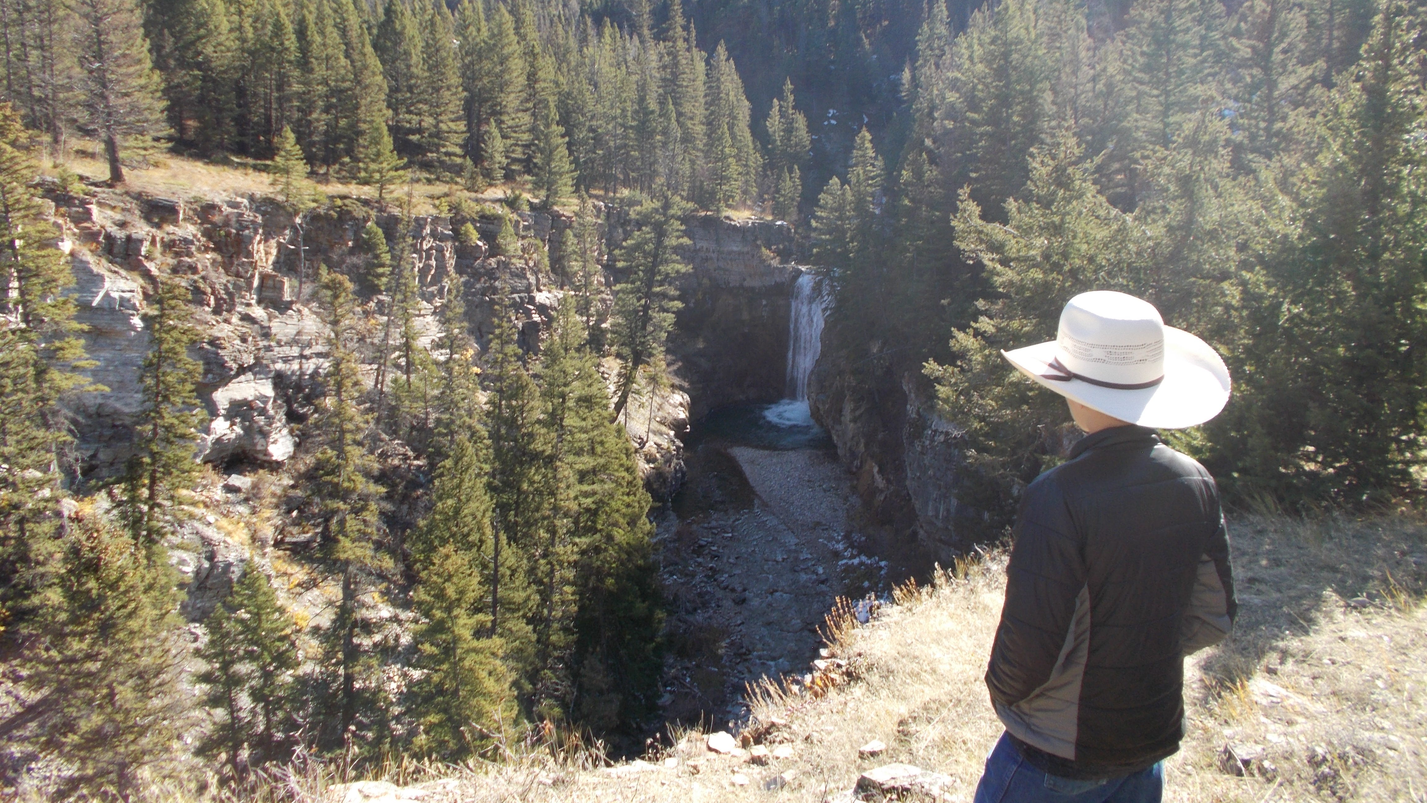 """Wyatt Barrett checks out a waterfall on Falls Creek west of Augusta. This location will become public under a land sale his father, Dan, is working on with the Rocky Mountain Elk Foundation. The purchase of 422 acres will open 26,000 additional acres of public land that's """"incredible elk country."""""""