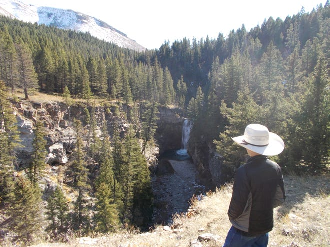Wyatt Barrett checks out a waterfall on Falls Creek southwest of Augusta. The location is now publicly accessible.