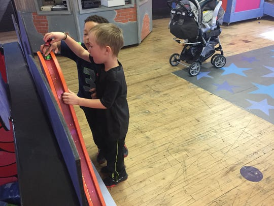 Cashius Taylor and Augustus Argotti, both 5, prepare to launch a diecast car on a wild ride at the Children's Museum of Montana in Great Falls.