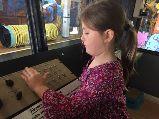 Morgan Galbraith, 6, runs the airport control switches in the Air Traffic Control Tower at the Children's Museum of Montana in Great Falls.
