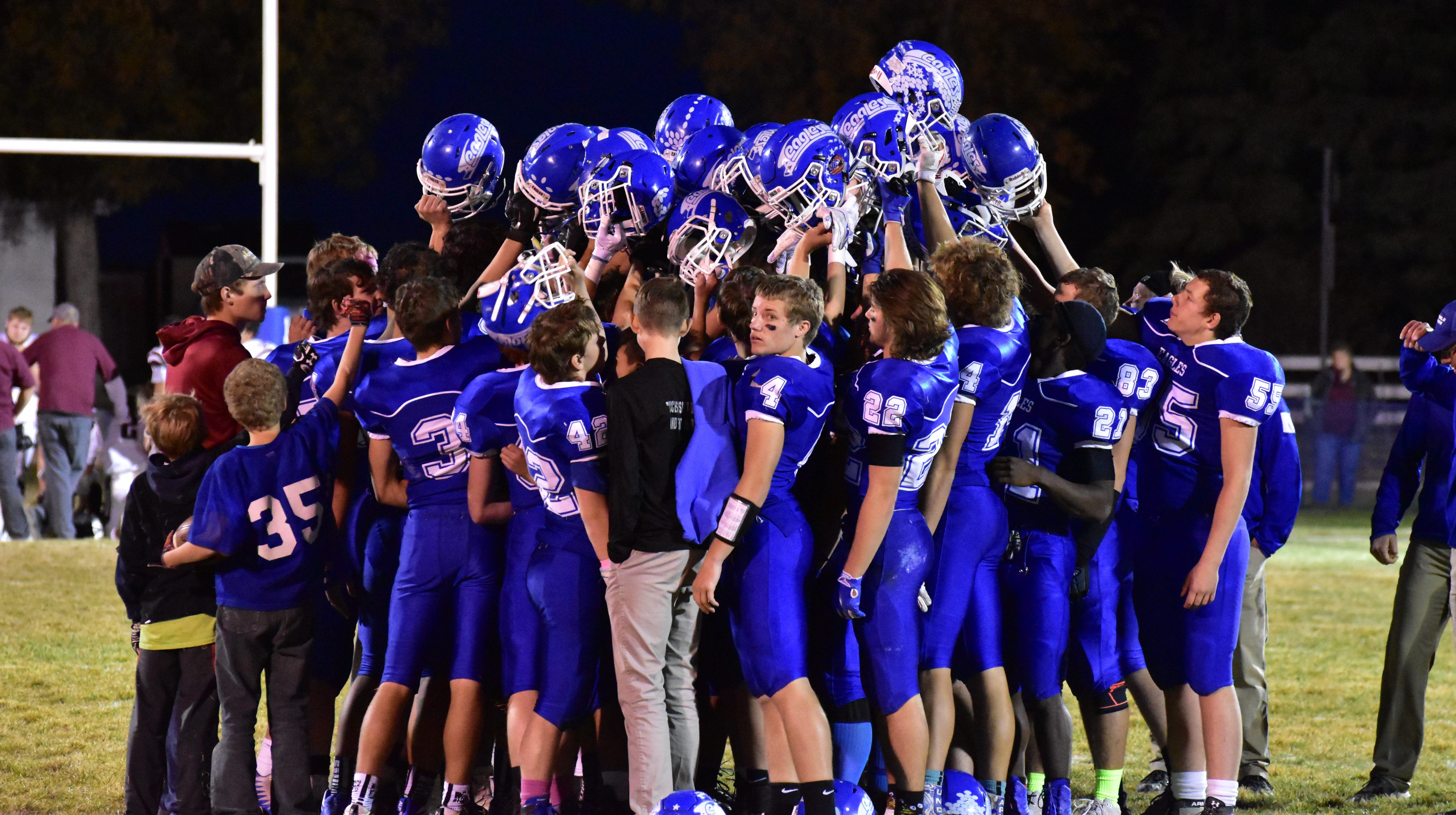The Fairfield football team celebrates a victory over Wolf Point Thursday night.